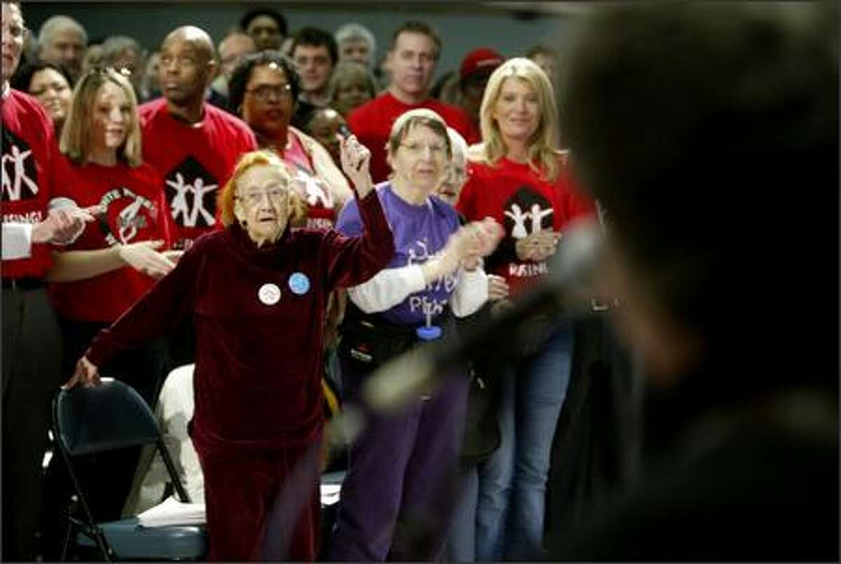 Irene Hull, a former union member, Jean Slocum, and various members of the Unite Here Local Eight sing along with Si Kahn, of Charlotte, N.C., the poet laureat of the AFL-CIO, as the group waits for Democratic presidential candidate John Edwards to arrive at a town hall style meeting Tuesday, May 1, 2007 in Seattle.