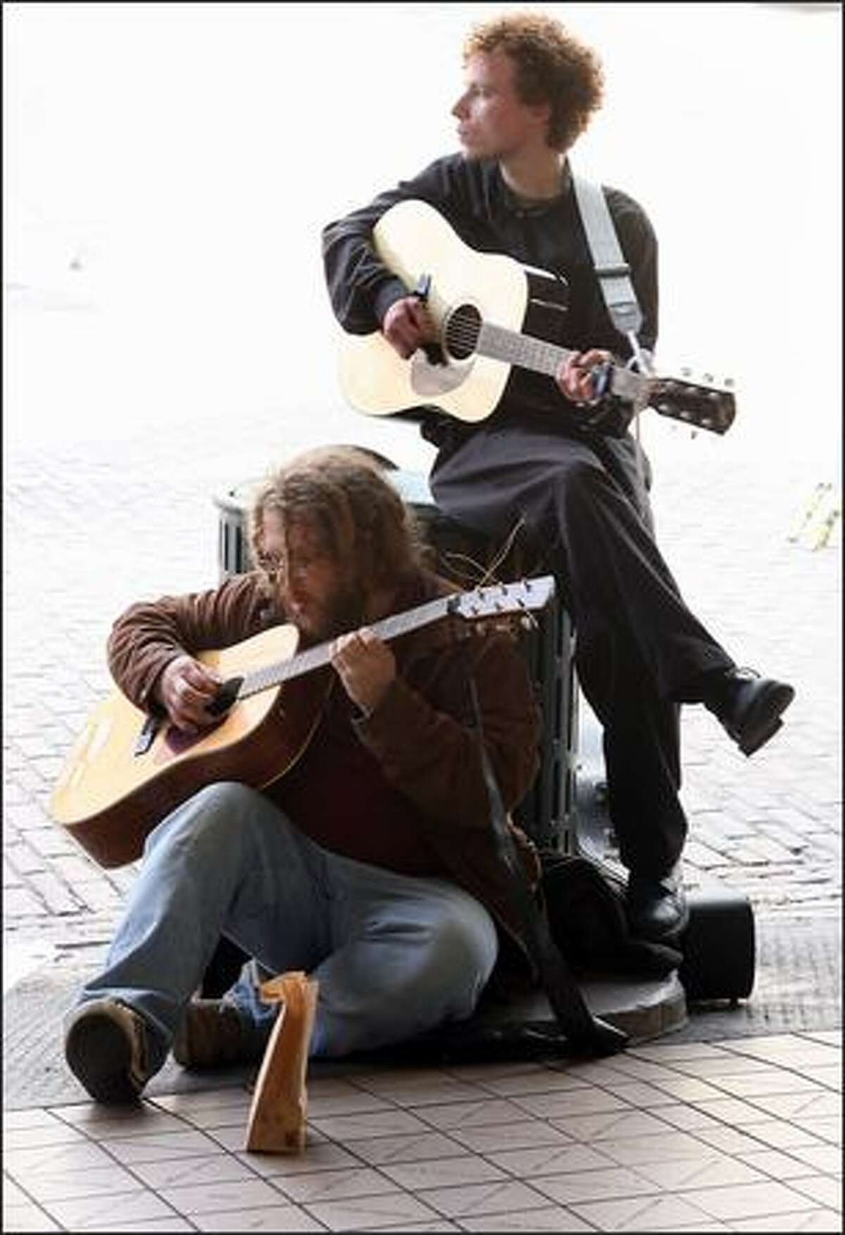 Street musicians Tommy Dean and Kind Kieth perfom at the Pike Place Market.