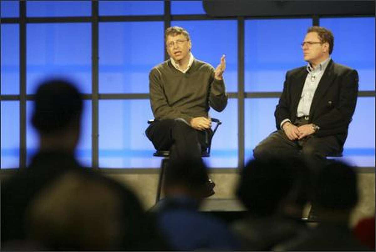 Bill Gates and Richard Kaplan take questions form attendees during a Q and A at the MVP Global Summit held at the Washington State Convention and Trade Center in Seattle Tuesday.