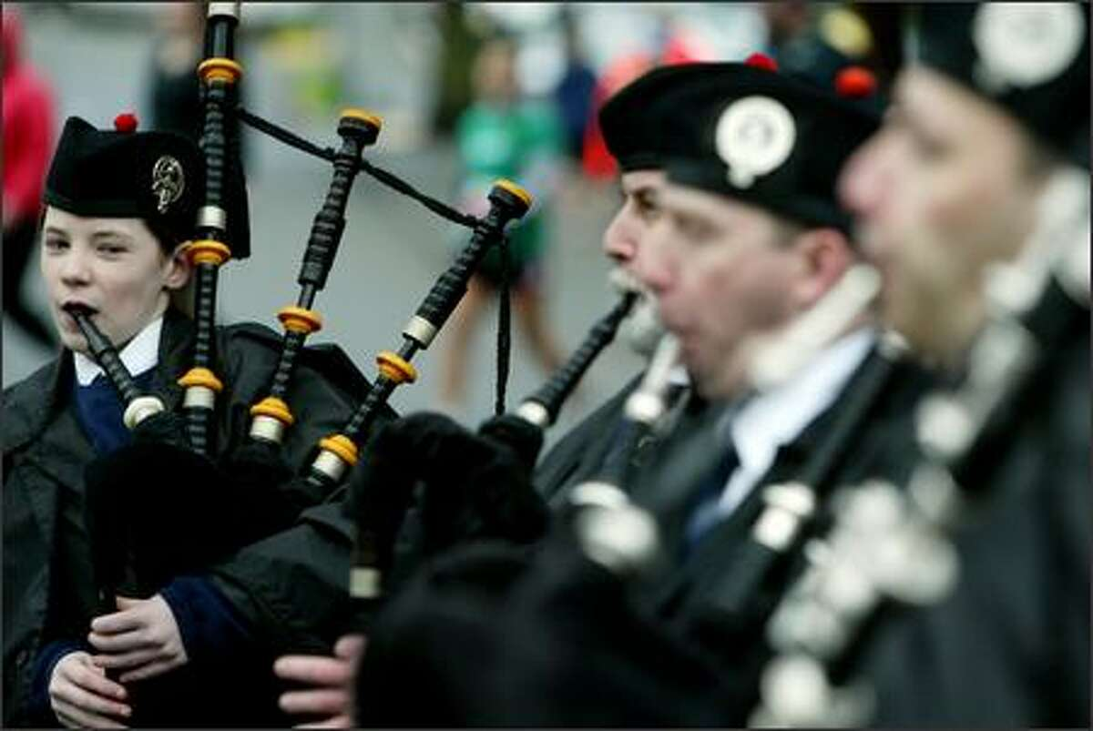 Katriona Mackay, 13, plays the bagpipes in the band at the starting line of the annual St. Patrick's Day Dash.
