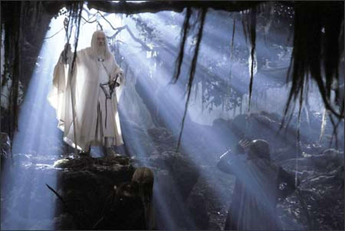 Gandalf the Grey (Ian McKellen) returns from his battle with the Balrog as Gandalf the White, much to the astonishment of Legolas, Gimli and Aragorn.