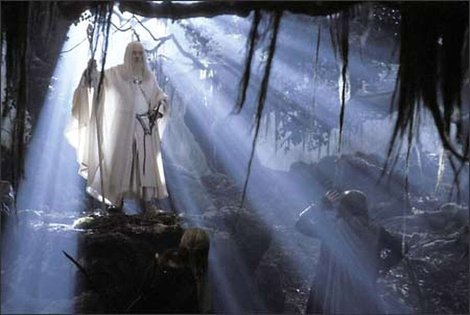 Gandalf the Grey (Ian McKellen) returns from his battle with the Balrog as Gandalf the White, much to the astonishment of Legolas, Gimli and Aragorn. Photo: New Line Cinema