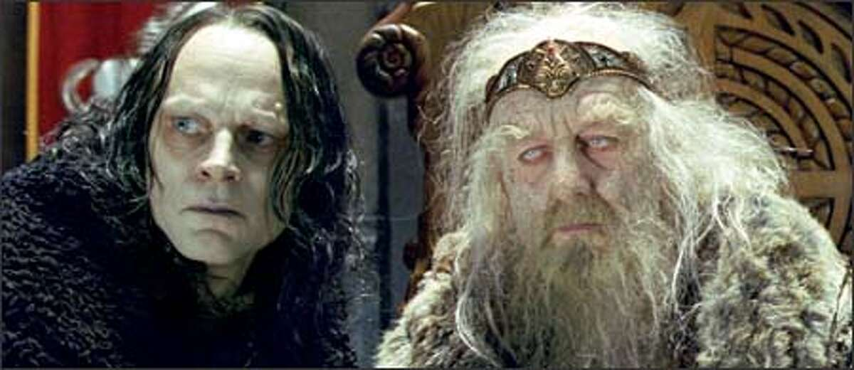 Wormtongue (Brad Dourif) advises the bewitched King Theoden (Bernard Hill), ruler of Rohan.
