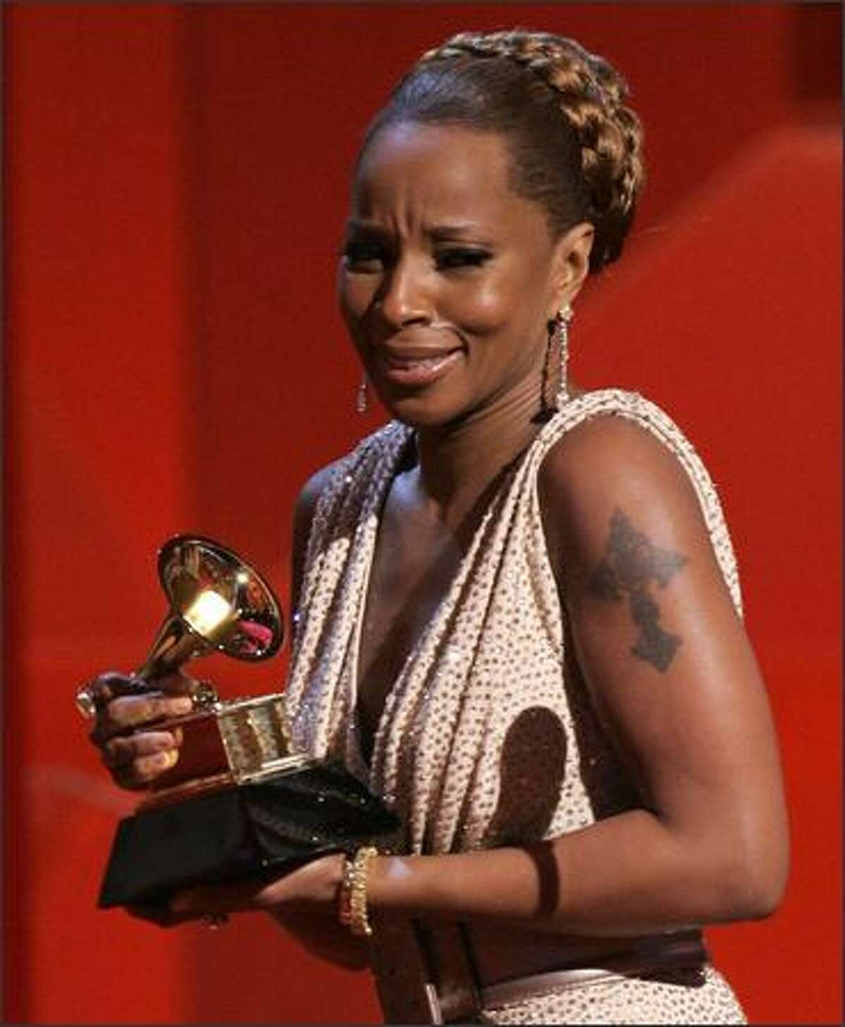 A tearful Mary J. Blige accepts the award for best female R&B vocal performance for