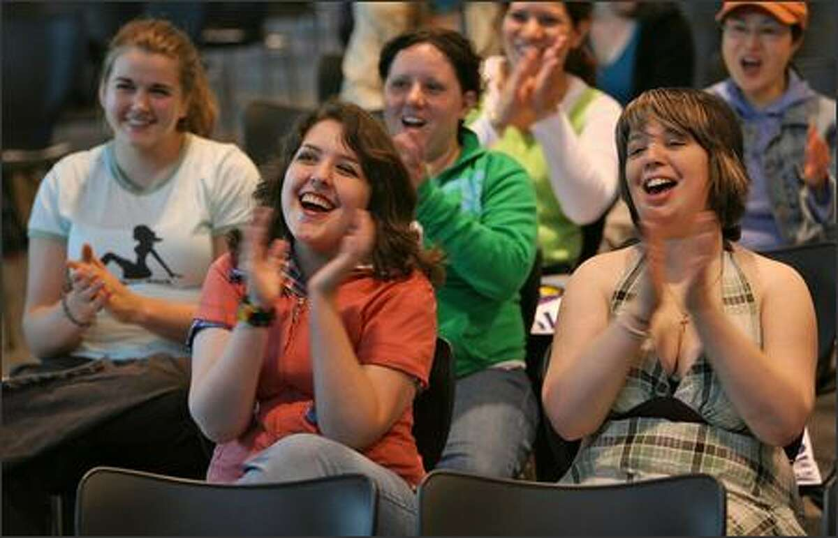Supporters of American Idol contestant Blake Lewis gathered at the University of Washington, Bothell, Events Center, near Seattle, Wash., Tuesday May 22, 2007, to watch the final performances via projection television. Front (l to r): Kaydria Mackay and Samantha Perrin, behind them Whitney Young and Desirae Freeze.