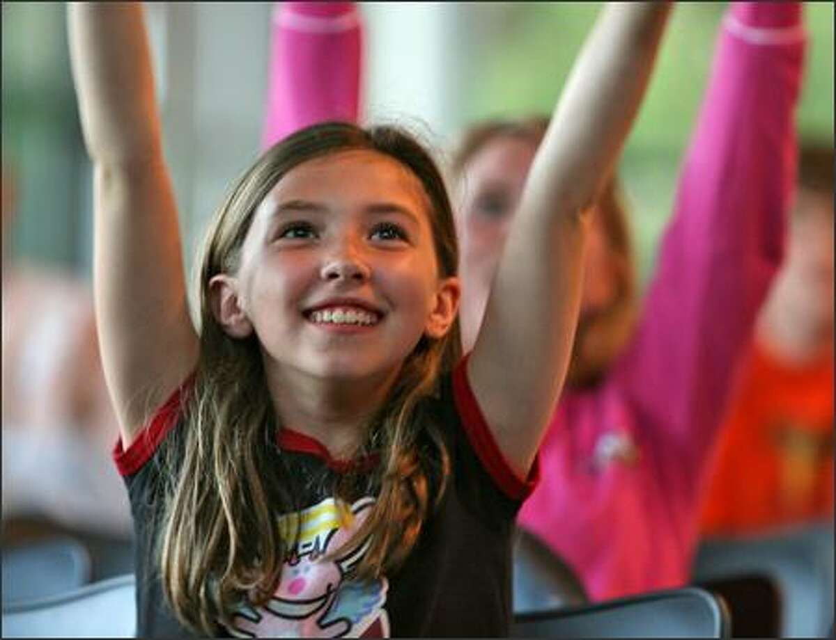 Hannah Kaspar, 9, cheers as supporters of American Idol contestant Blake Lewis gathered at the University of Washington, Bothell, Events Center, near Seattle, Wash., Tuesday May 22, 2007, to watch the final performances via projection television.