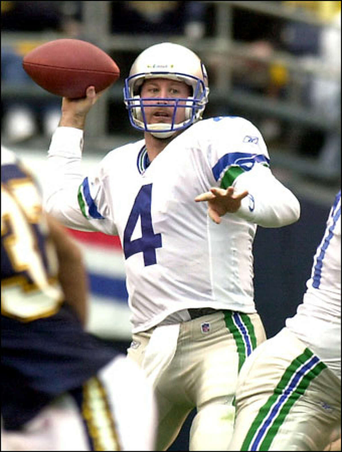 Trent Dilfer aims a pass, one of 23 attempted against the Chargers. He completed 14 for 267 yards and three TDs. Dilfer is 3-0 as the Seahawks starter and has won 14 games in a row.