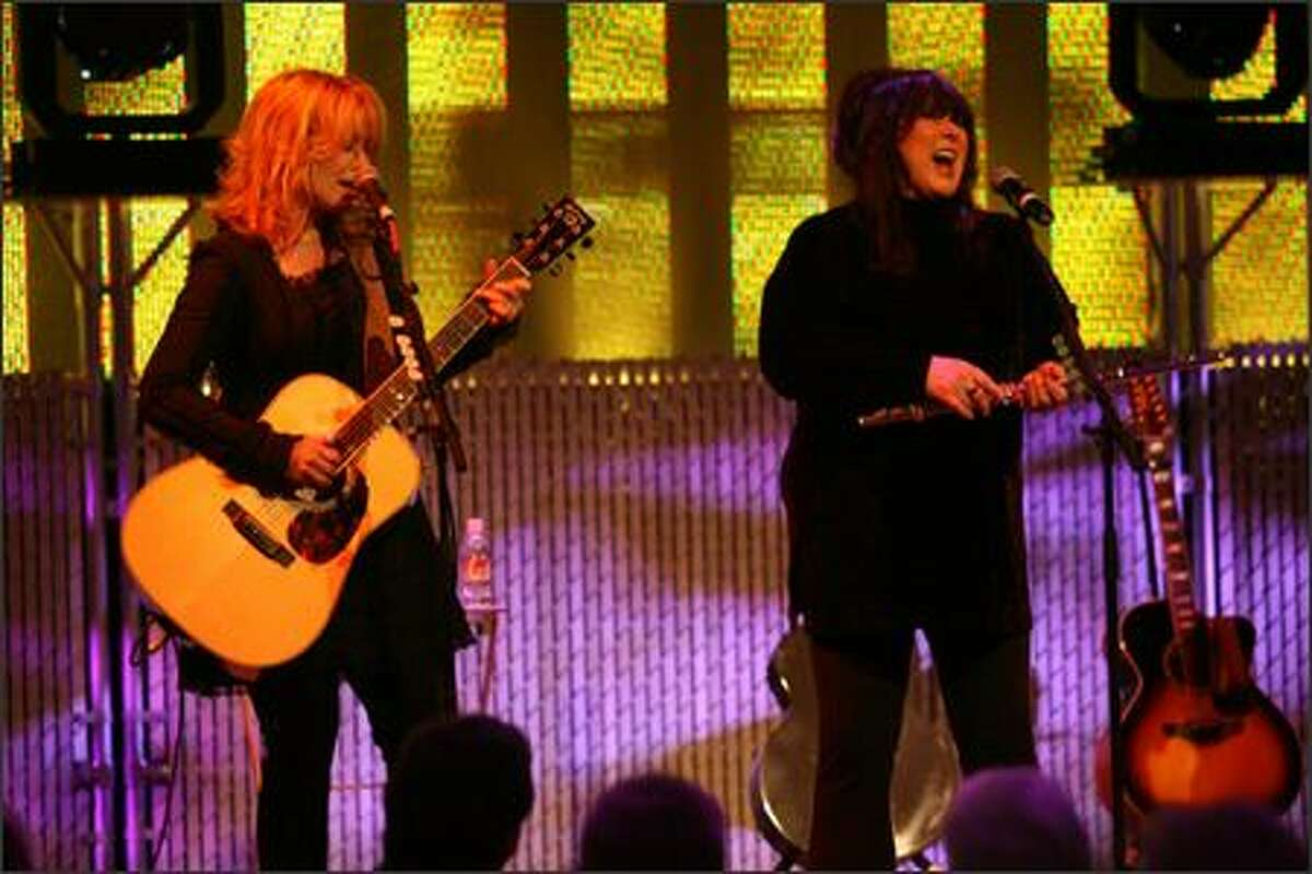 Nancy and Ann Wilson of Heart perform at the Experience Music Project Thursday night. EMP presented the sisters with the Inaugural Founders' Award, presented to artists who have made outstanding contributions to their respective fields. Proceeds benefited the City Music Program, offering free music education to middle school and high school students.