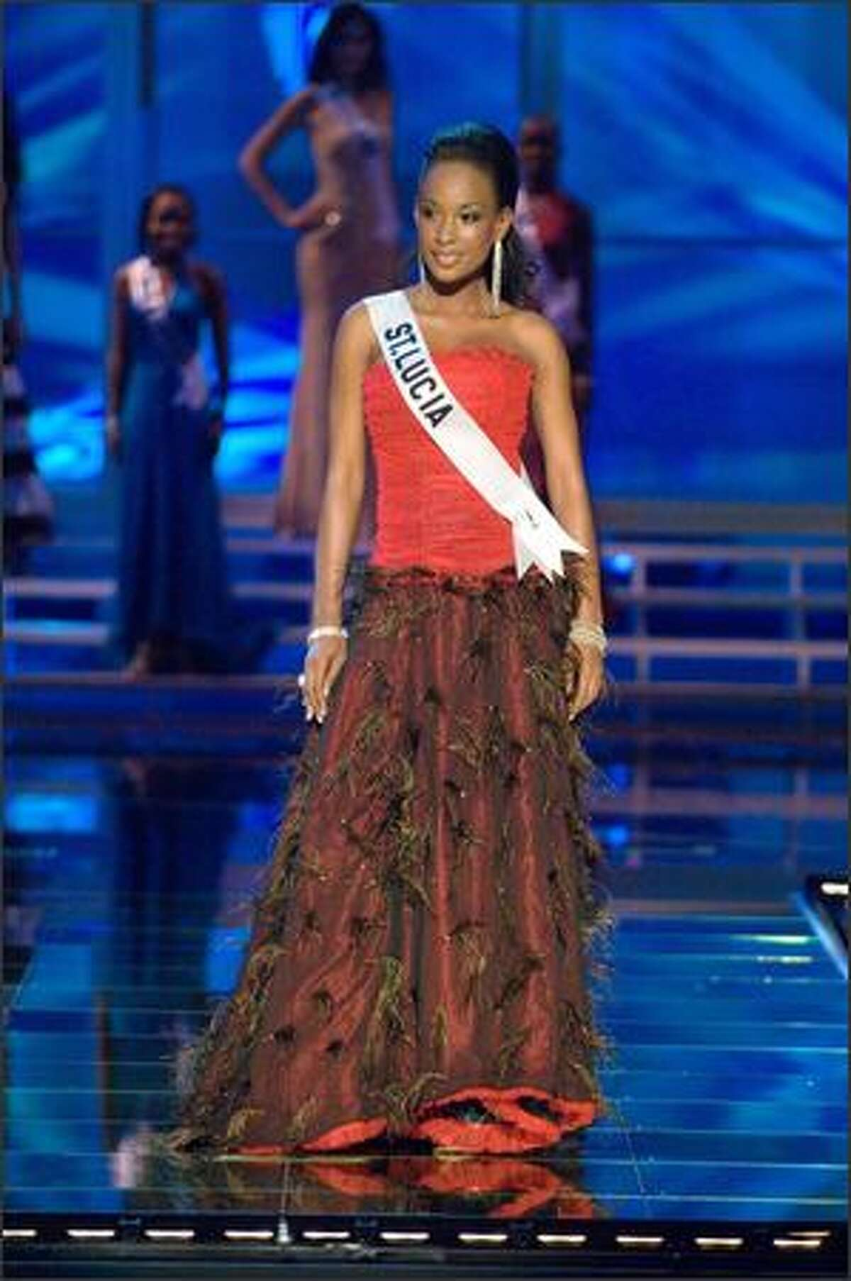 Yoanna Henry, Miss St. Lucia 2007, competes in an evening gown of her choice during the 2007 Miss Universe Presentation Show at Auditorio Nacional in Mexico City on May 23. During the Presentation Show, each is judged by a preliminary panel of judges in individual interview, swimsuit and evening gown categories. The scores will be tallied and the top 15 contestants will be announced during the broadcast of the finals on May 28 (9 p.m. Pacific, tape-delayed).