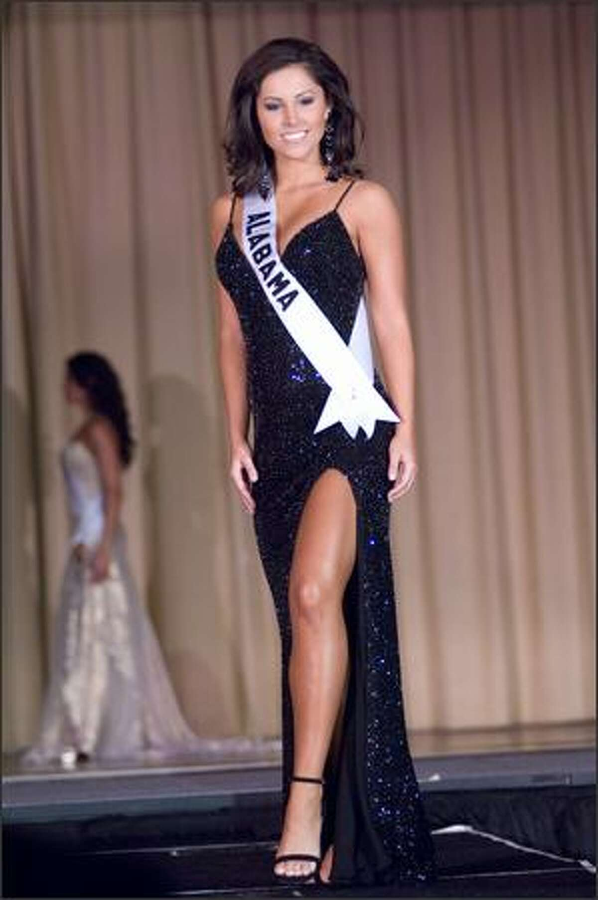 Rebecca Moore, Miss Alabama USA 2007, competes in an evening gown of her choice during the Miss USA 2007 Preliminary Event at the Wilshire Grand Hotel in Los Angeles on March 19. Each contestant was judged by a panel of judges in individual interview, swimsuit and evening gown categories. The scores will be tallied and the top 15 contestants will be announced during the NBC telecast on March 23.