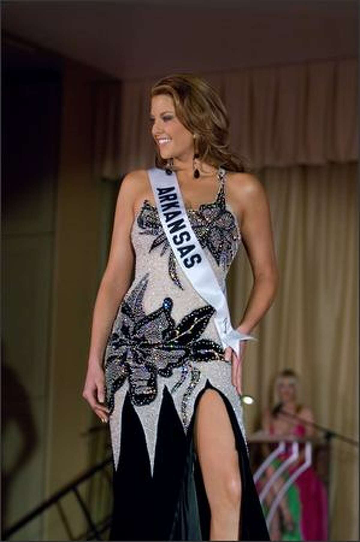 Kelly George, Miss Arkansas USA 2007, competes in an evening gown of her choice during the Miss USA 2007 Preliminary Event at the Wilshire Grand Hotel in Los Angeles on March 19. Each contestant was judged by a panel of judges in individual interview, swimsuit and evening gown categories. The scores will be tallied and the top 15 contestants will be announced during the NBC telecast on March 23.