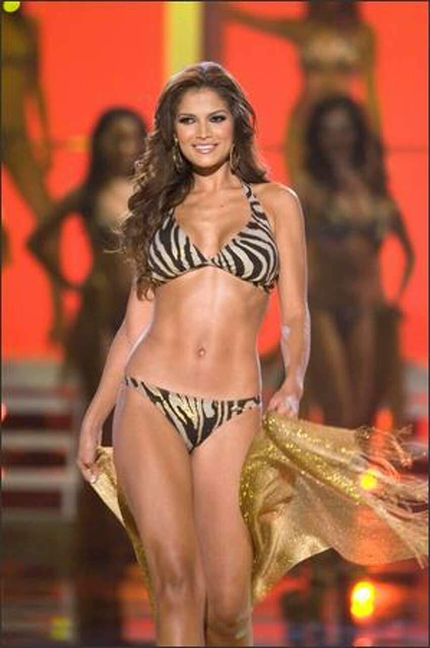 Ly Jonaitis, Miss Venezuela 2007, one of the 15 semifinalists, participates in the swimsuit portion of the broadcast of the 2007 Miss Universe competition from the Auditorio Nacional in Mexico City.