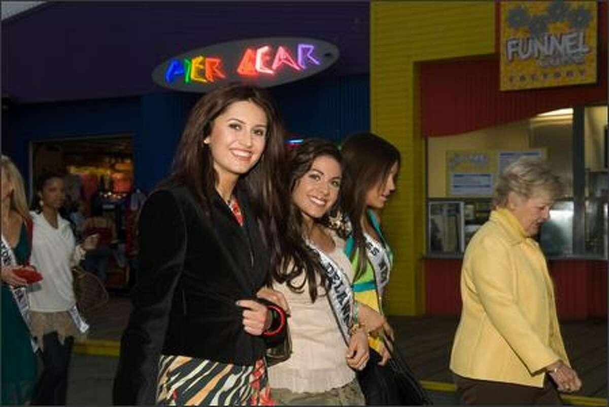 Alla Ilushka, Miss Minnesota USA 2007, Nicole Bosso, Miss Delaware USA 2007, and Helen Salas, Miss Nevada USA 2007, walk down the Santa Monica Pier in Santa Monica, Calif., on March 13.