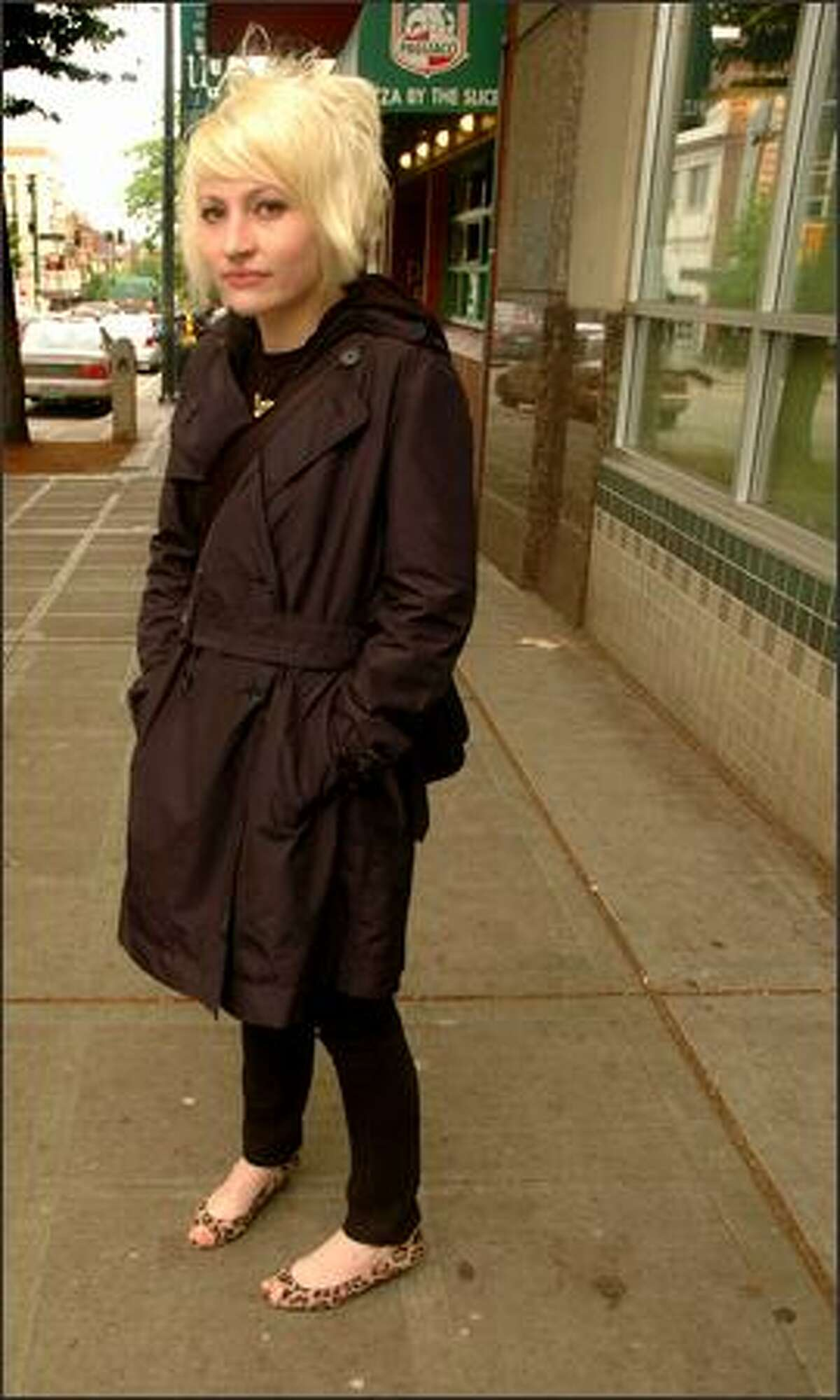 """Robyn Scott stands across the street from Buffalo Exchange, where she shops and works, on Monday. Scott describes her style as """"eclectic."""""""