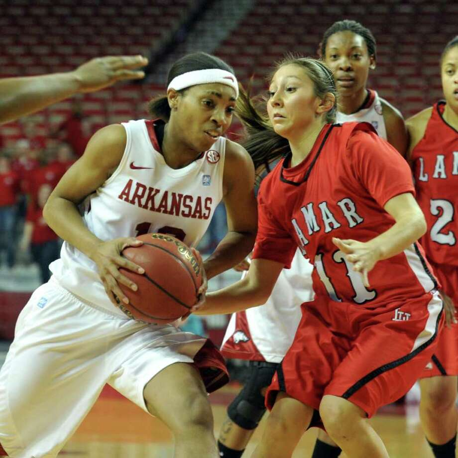Arkansas Democrat-Gazette/MICHAEL WOODS  --03/17/11--  University of Arkansas forward Chrisstasia Walter drives to the hoop against Lamar defender Jenna Plumley in the first half Thursday's first round game of the National Women's Invitational Tournament at Bud Walton Arena in Fayetteville. Photo: Michael Woods / Beaumont