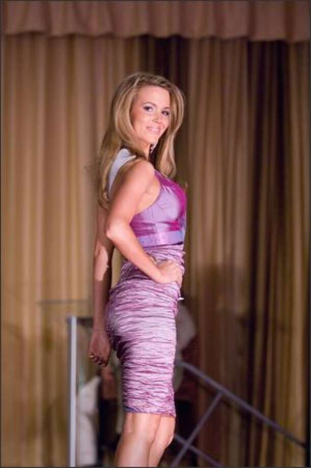 Courtney Lorraine Barnas, Miss Arizona USA 2007, opens the Miss USA 2007 Preliminary Event at the Wilshire Grand Hotel in Los Angeles on March 19. During the Preliminary Event, each contestant was judged by a panel of judges in individual interview, swimsuit and evening gown categories. The scores will be tallied and the top 15 contestants will be announced during the telecast on March 23. Photo: Miss Universe L.P., LLLP