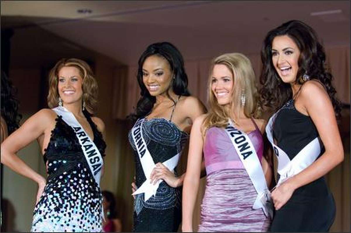 Kelly George, Miss Arkansas USA 2007, Meagan Yvonne Tandy, Miss California USA 2007, Courtney Lorraine Barnas, Miss Arizona USA 2007, and Keena Bonella, Miss Colorado USA 2007, open the Miss USA 2007 Preliminary Event at the Wilshire Grand Hotel in Los Angeles on March 19. During the Preliminary Event, each contestant was judged by a panel of judges in individual interview, swimsuit and evening gown categories. The scores will be tallied and the top 15 contestants will be announced during the telecast on March 23.