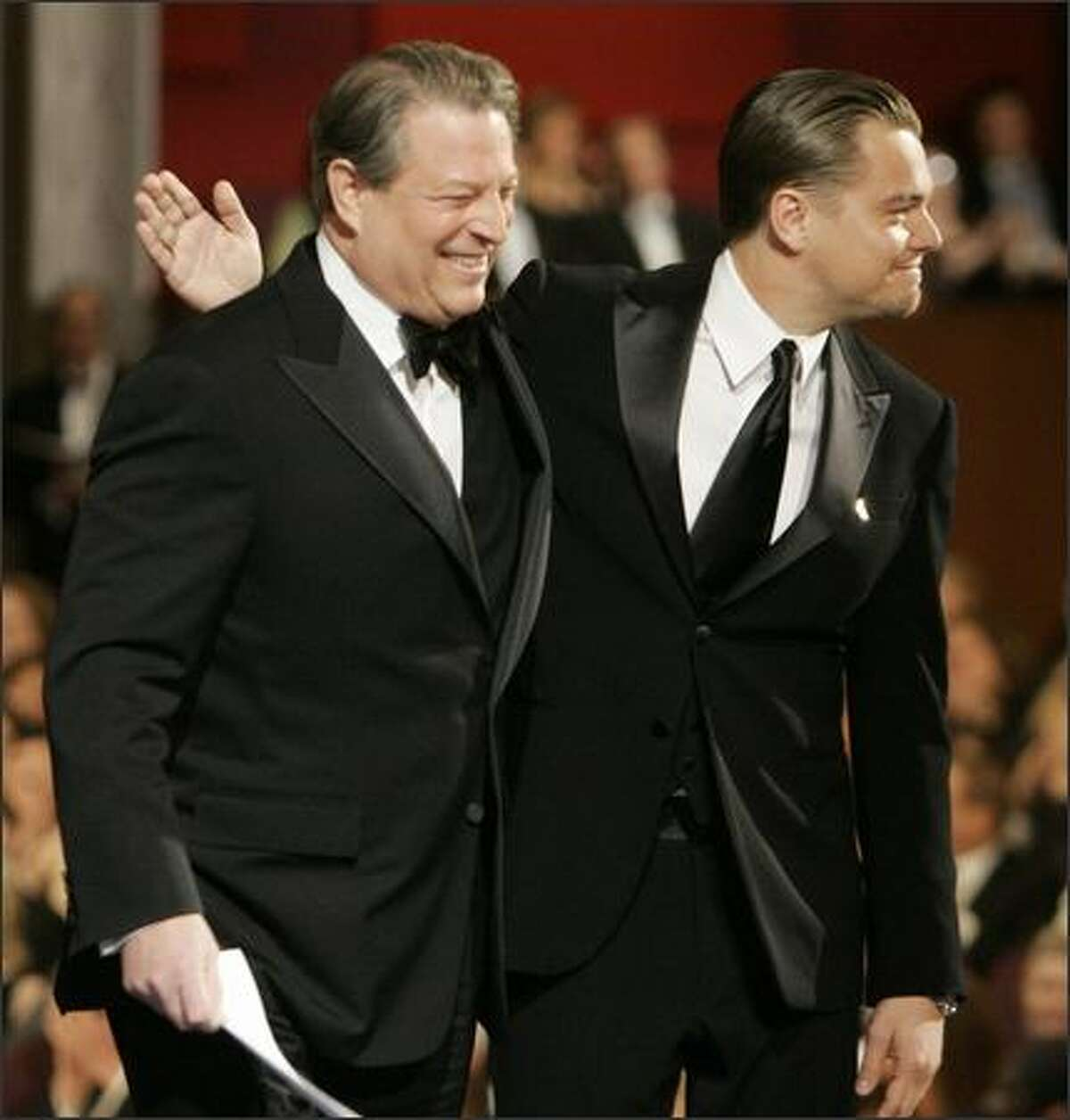 Former Vice President Al Gore, left, and Leonardo DiCaprio walk off stage during the 79th Academy Awards at the Kodak Theatre in Los Angeles Sunday. (AP Photo/Chris Carlson)