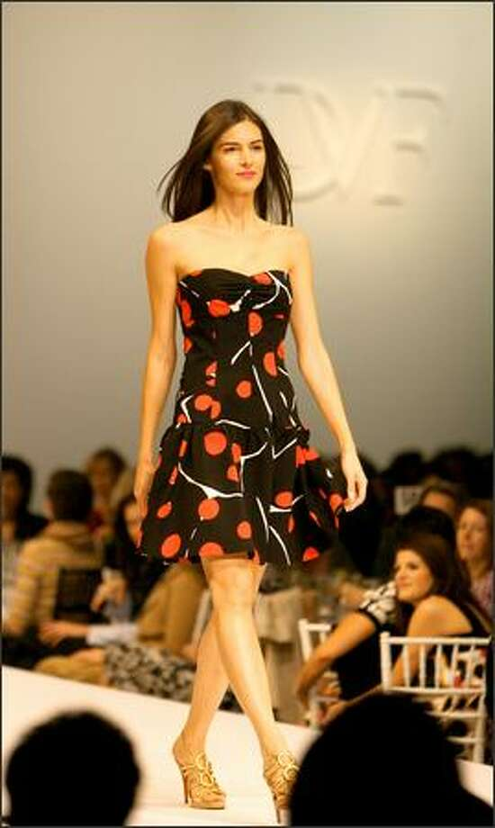 "A model displays a ladybug-print ""Basilica"" strapless dress at the annual Nordstrom Fashion Ovation fashion show to benefit Seattle Repertory Theatre, centering on designs by special guest Diane von Furstenberg. Photo: Scott Eklund, Seattle Post-Intelligencer"