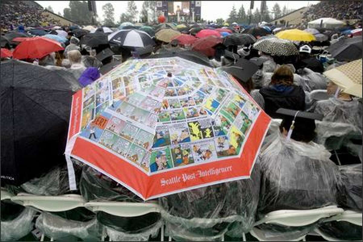An old P-I Sunday Comics umbrella makes an appearance on the floor of Husky Stadium.