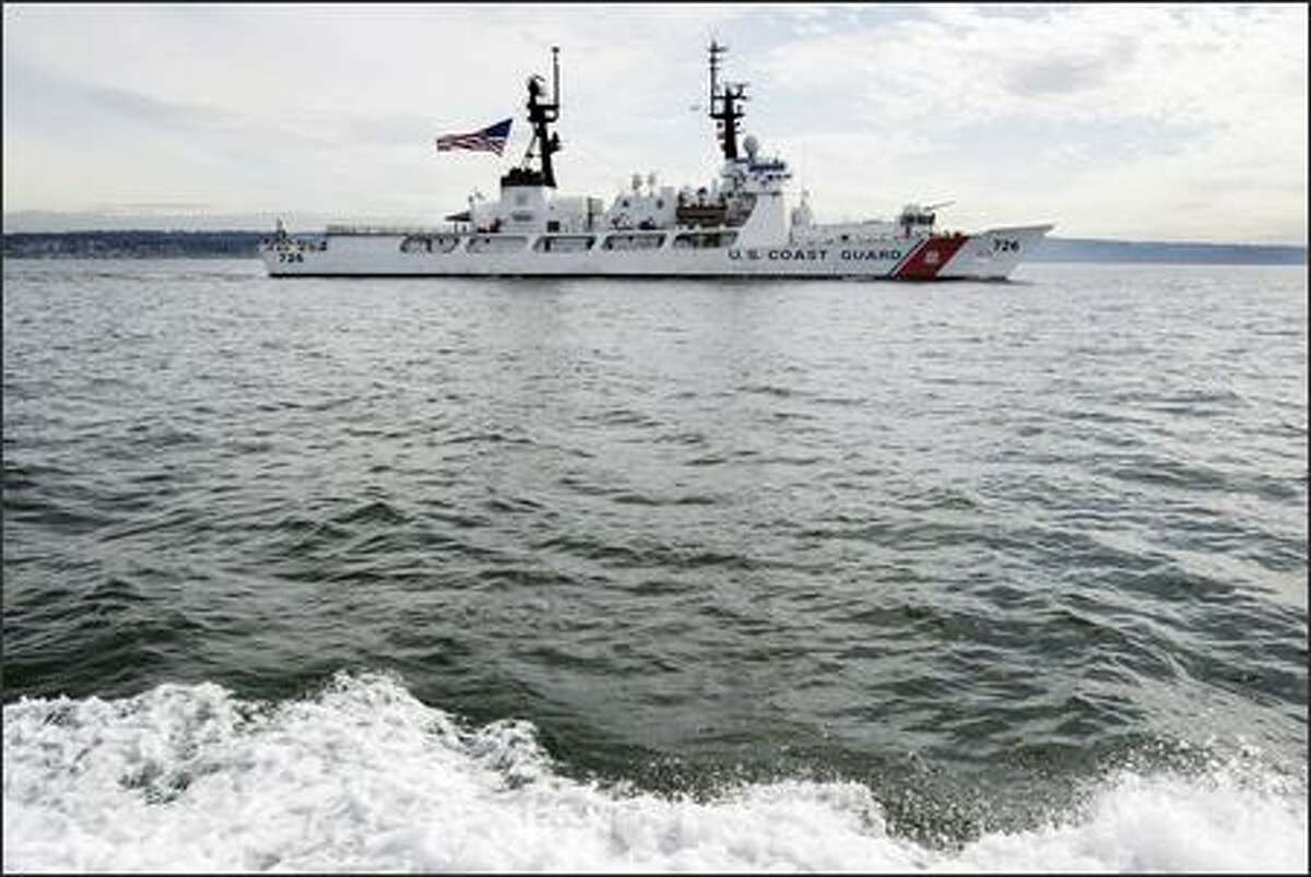 The U.S. Coast Guard Cutter Midgett races towards its homeport of Pier 36 in Seattle Friday, March 16, 2007. The 378-foot cutter is completing a six month deployment that included extensive anti-piracy, maritime security and interdiction operations in the Middle East with coalition forces. Midgett then embarked on a global circumnavigation to return to Seattle.