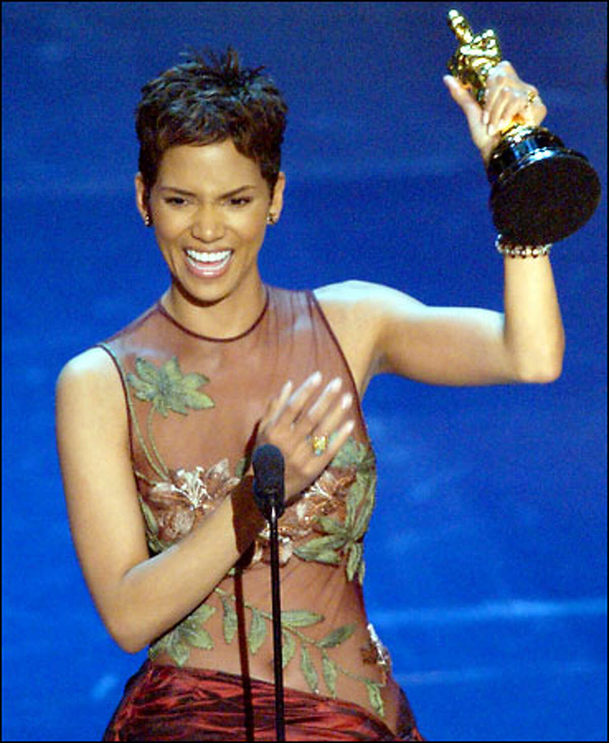 Halle Berry raises up the Oscar she won for best actress for her work in