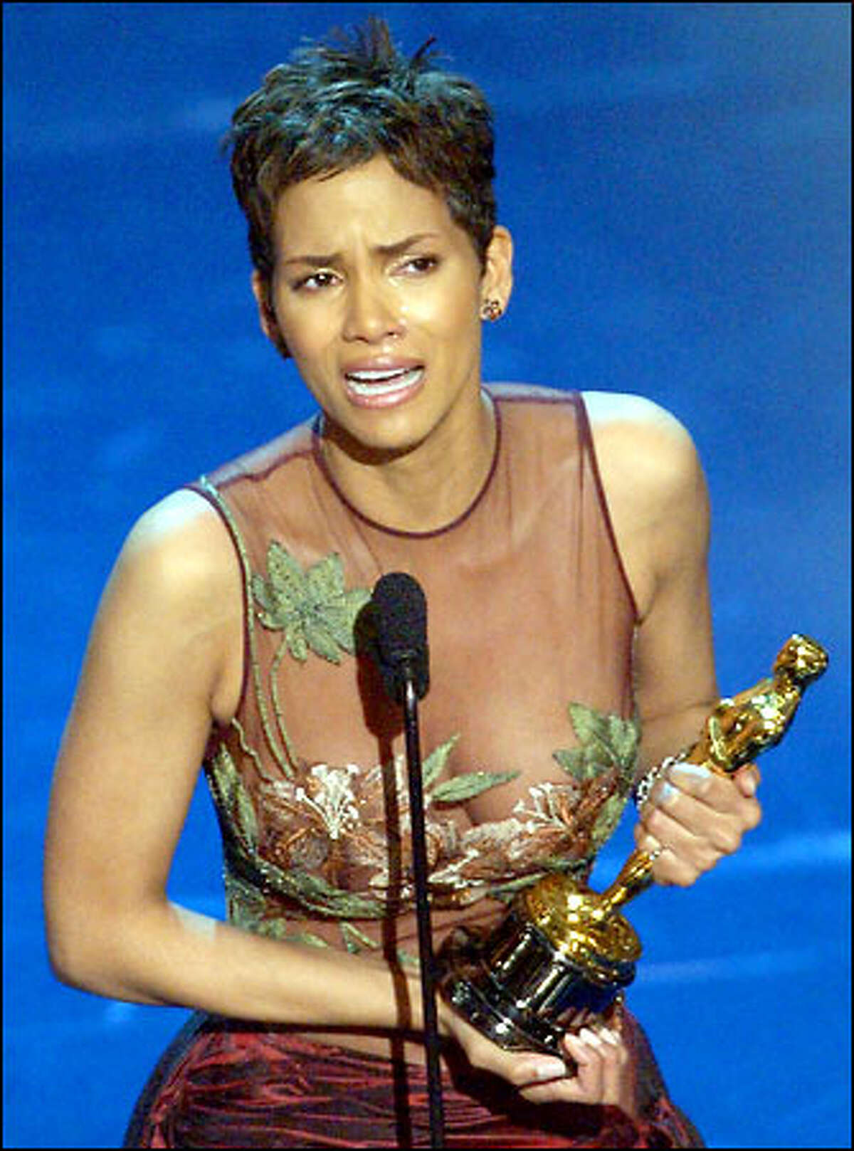 Halle Berry cries as she accpets the Oscar for best actress in the film