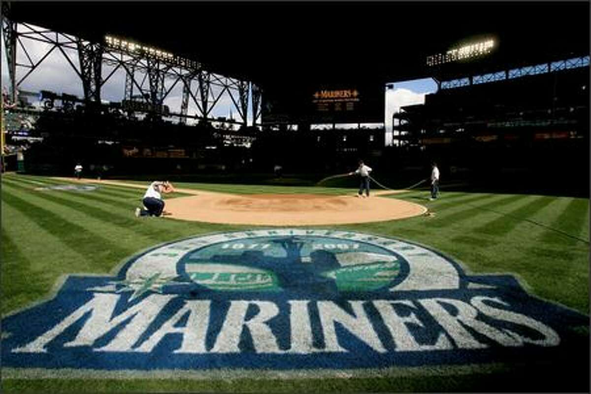 Field preparations during opening day at Safeco Field.
