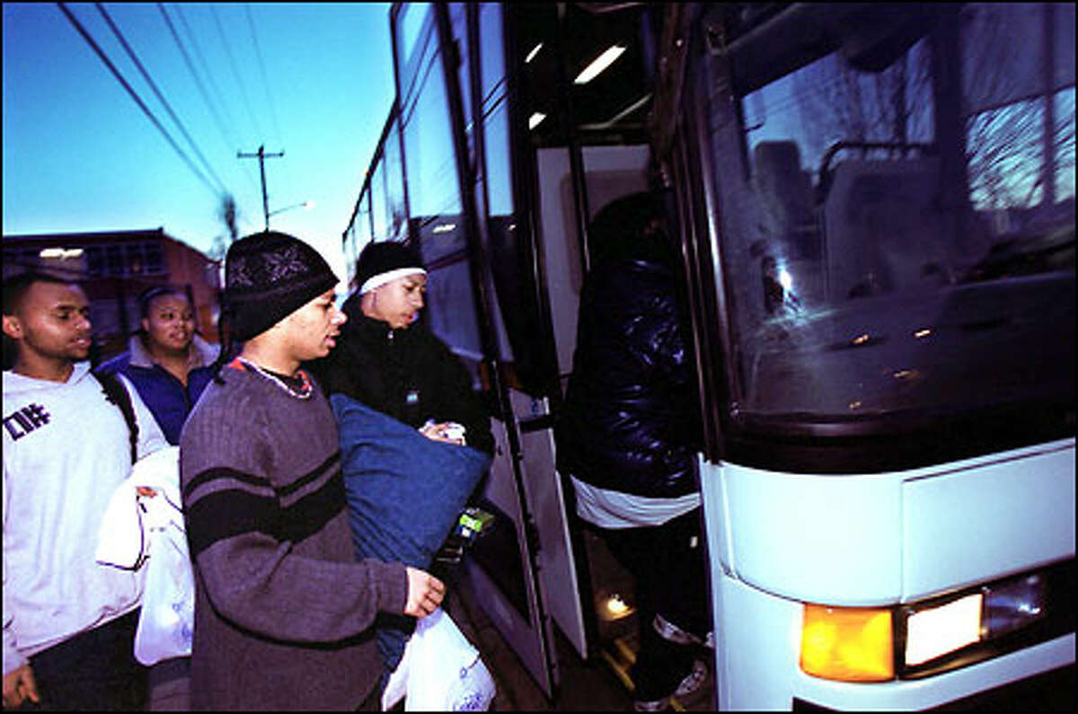 Students from Rainier Beach High School board a bus for a pre-dawn departure for the long ride to a Future Teachers of Color recruiting trip weekend at Washington State University. The shortage of teachers of color is regarded as one factor for disproportionate discipline rates and academic gaps between African-American and white students.