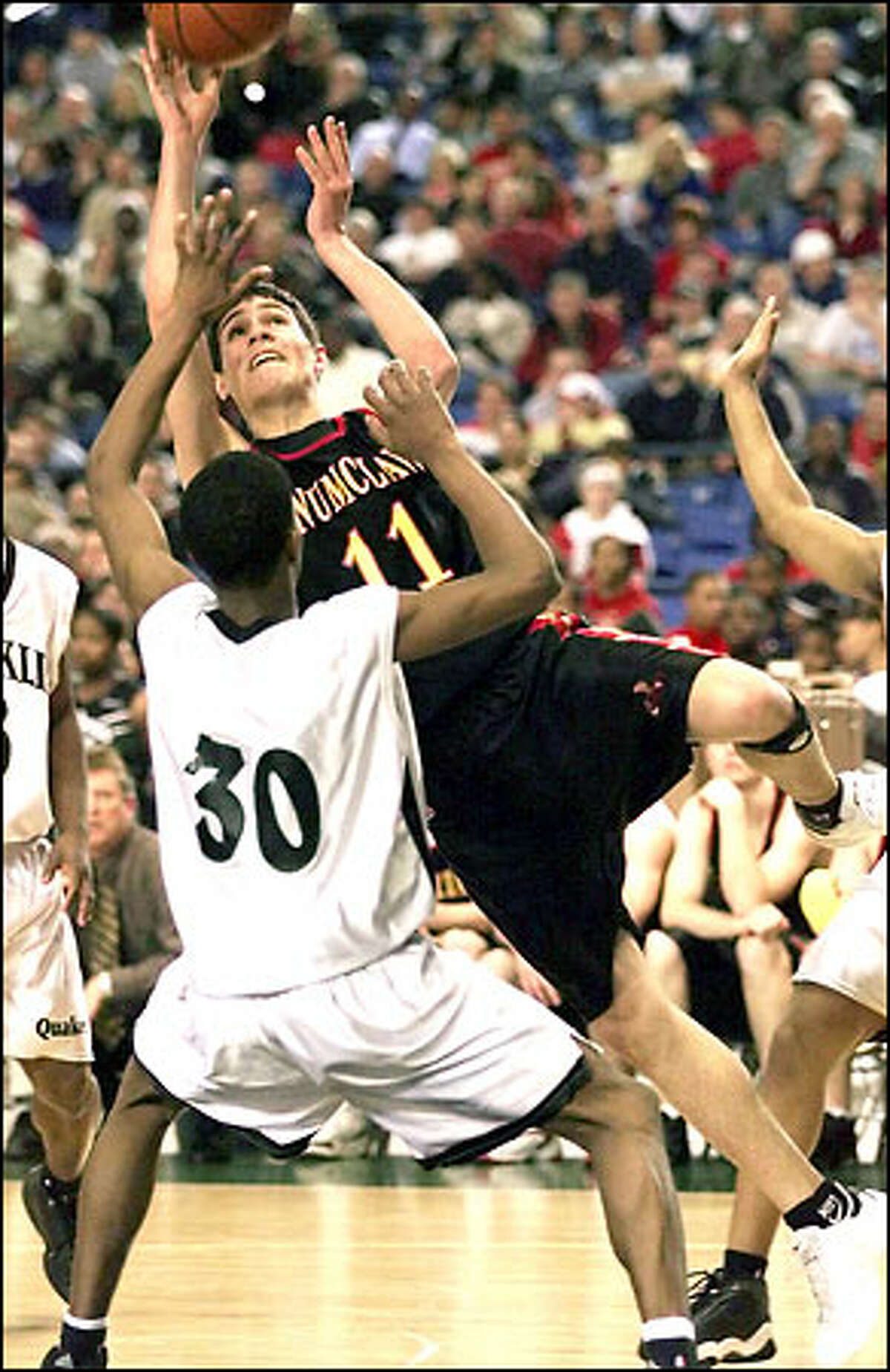 Enumclaw's Tony Binetti slams into Franklin's Aaron Brooks during the second half of their playoff game at the Tacoma Dome Thursday March 8, 2002.