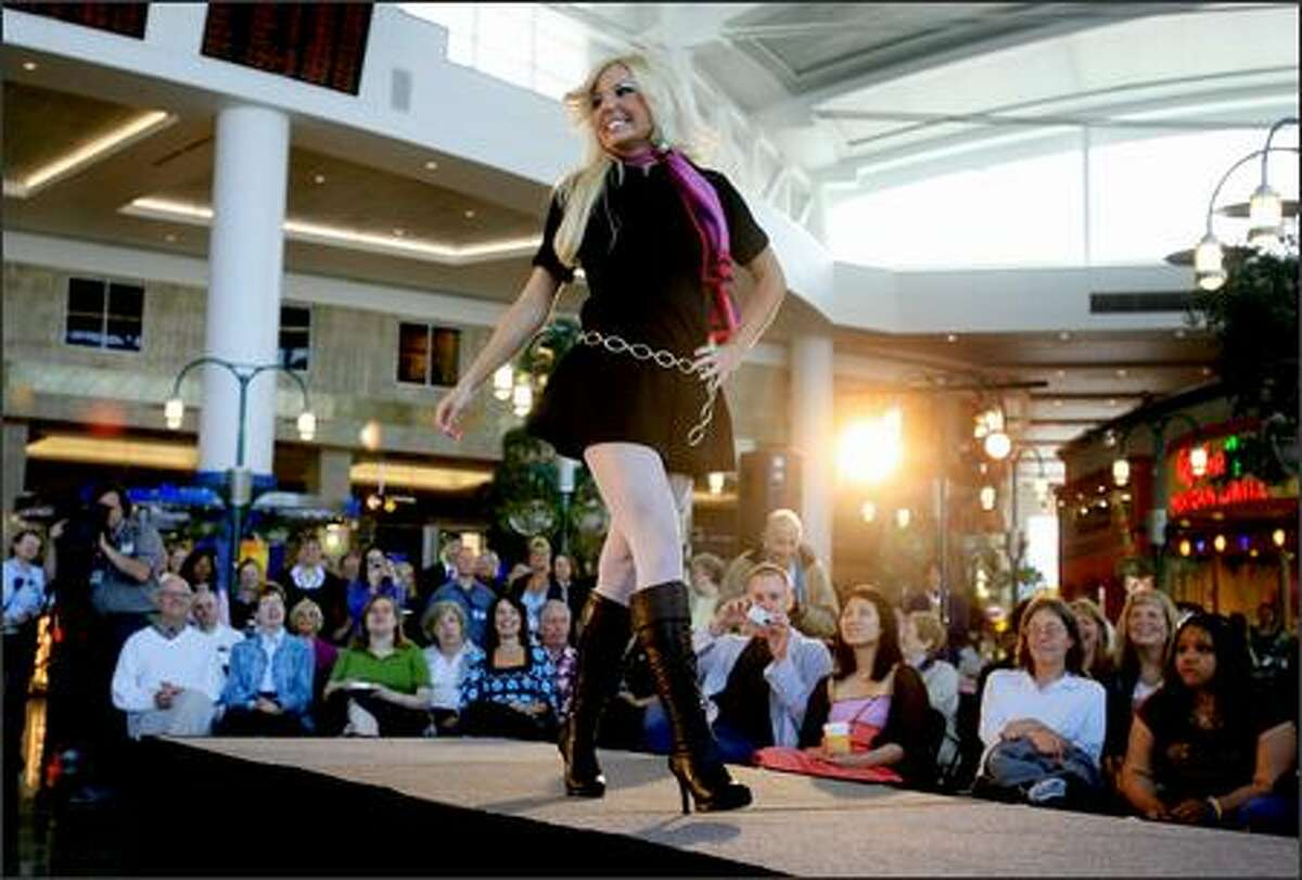 Alaska Airlines flight attendant Denise Taylor models hot pants during a fashion show of uniforms worn by Alaska attendants in decades past at the Seattle-Tacoma International Airport's Central on Thursday.