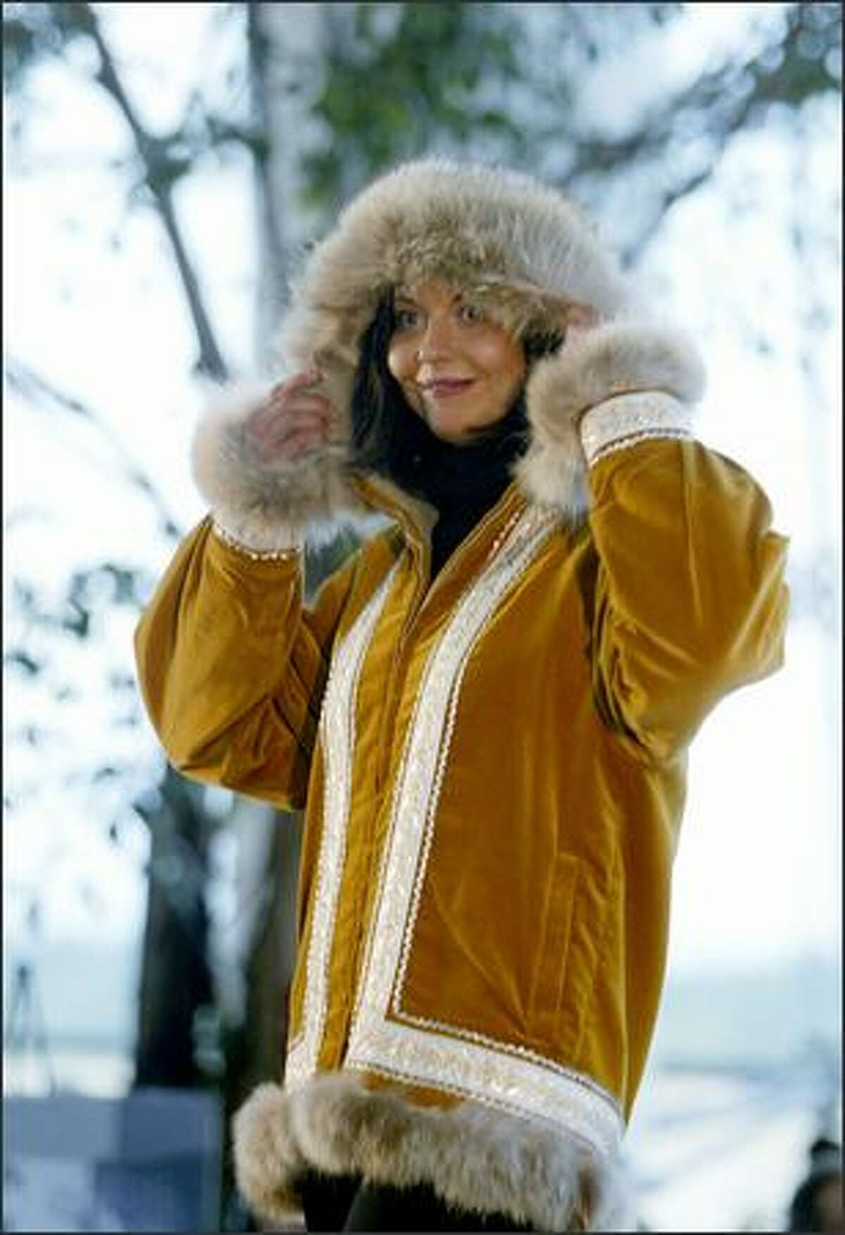 Alaska Airlines flight attendant Melissa Falcone models an Arctic Parka as worn by Alaska attendants in the 1950s and 60s during a fashion show of uniforms worn by attendants in decades past at the Seattle-Tacoma International Airport's Central Terminal on Thursday.