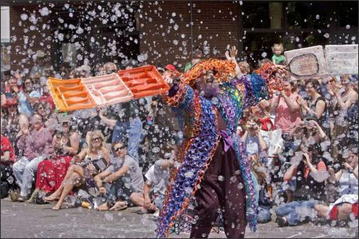 A man generates soap bubbles during the parade.