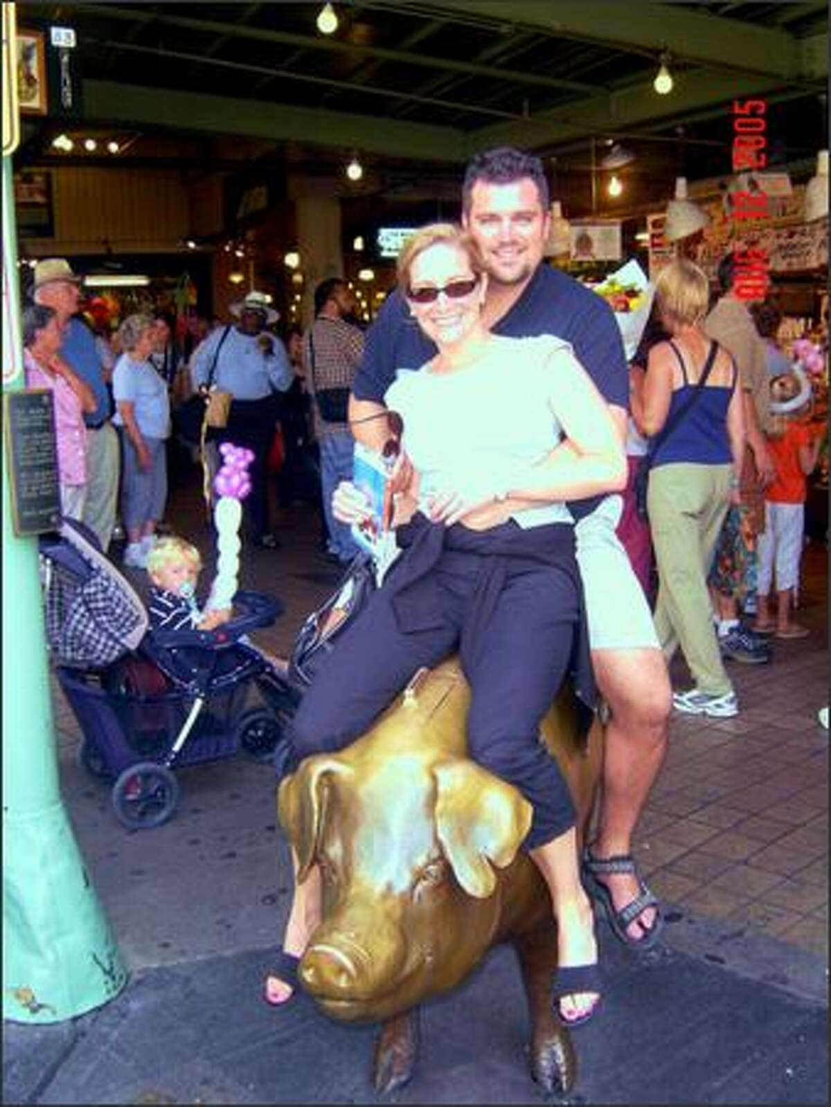 """""""It's like being back on Grandpa's farm in Iowa!"""", Dustin and Sara Riedel from Milford, Connecticut, riding Rachel at the Market while visiting their folks in Renton. (submitted by Marlys)"""