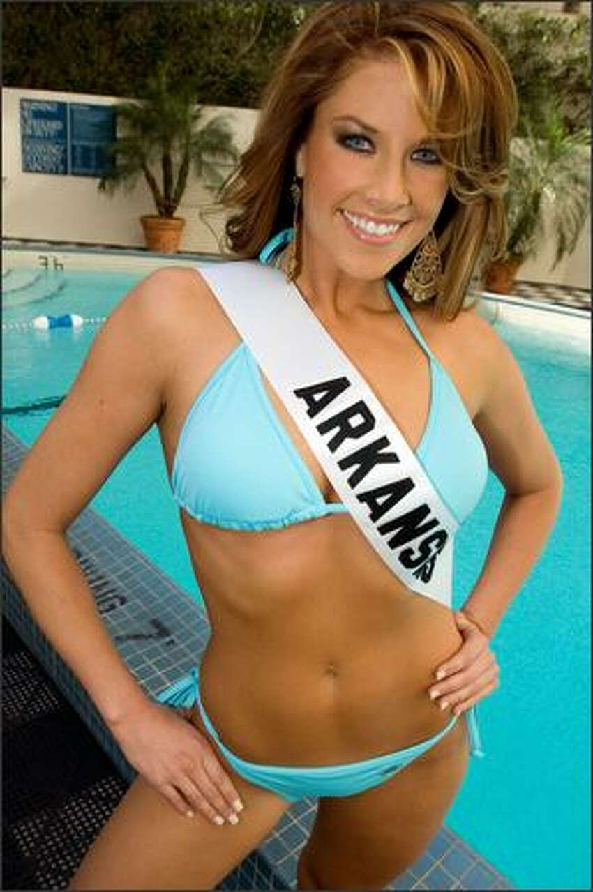 Kelly George, Miss Arkansas USA 2007, poses in her swimwear by BSC Thailand at the pool at the Wilshire Grand Hotel in Los Angeles on March 8, 2007. She will compete for the title of Miss USA 2007 during the NBC telecast of the 56th annual Miss USA competition on March 23 at 9 p.m. (ET/delayed PT) from Los Angeles.