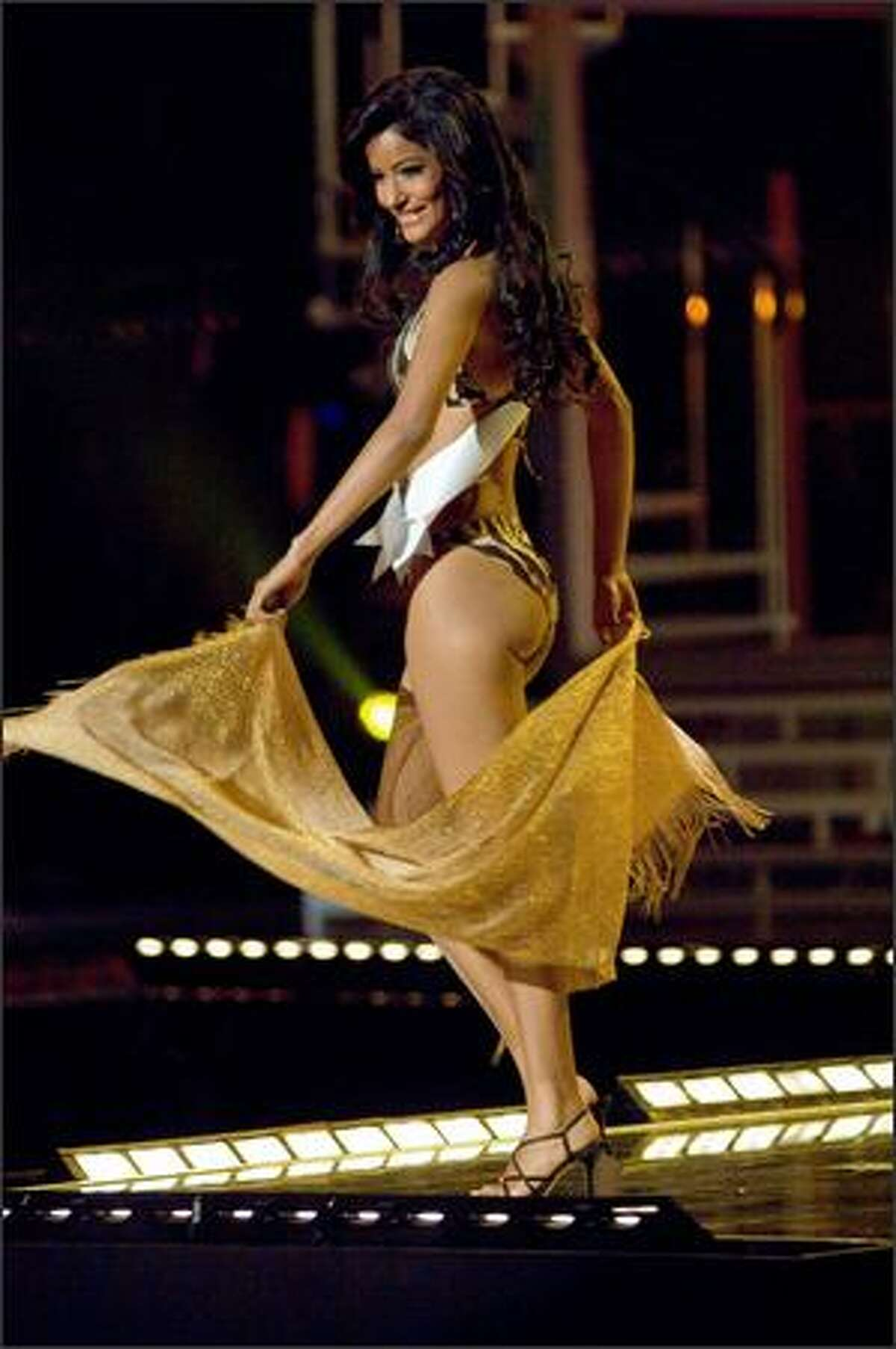 Massiel Taveras, Miss Dominican Republic 2007, competes in her BSC Swimwear Thailand swimsuit and Nina Shoes during the 2007 Miss Universe Presentation Show at Auditorio Nacional in Mexico City on May 23. During the Presentation Show, each contestant is judged by a preliminary panel of judges in individual interview, swimsuit and evening gown categories. The scores will be tallied and the top 15 contestants will be announced during the broadcast of the finals on May 28 (9 p.m. Pacific, tape-delayed).