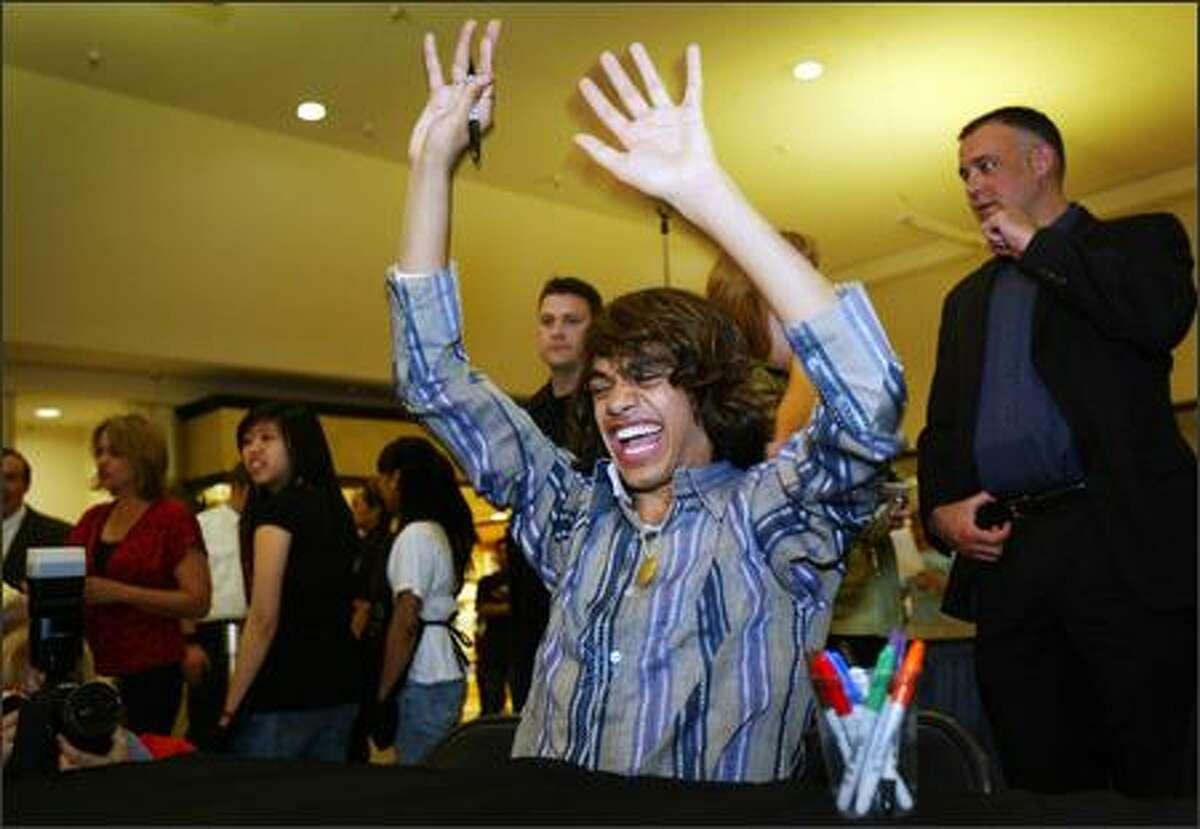 """""""American Idol"""" contestant Sanjaya Malakar hypes up fans at The Commons at Federal Way."""