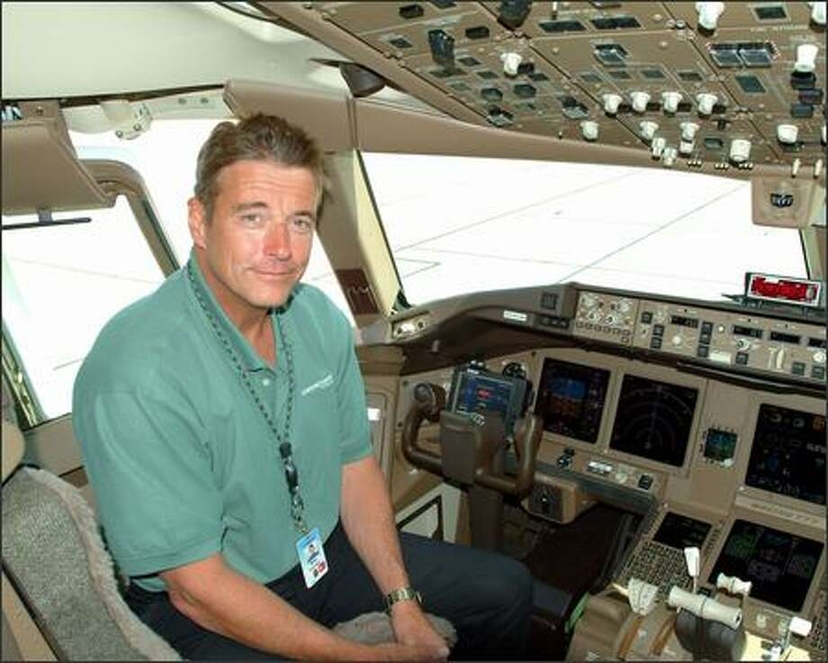 Boeing pilot and engineer Mike Carriker, seen here in the cockpit of a 777, will be in the left seat -- as command pilot -- when the 787 makes its first flight in 2007. Photo: / The Boeing Company