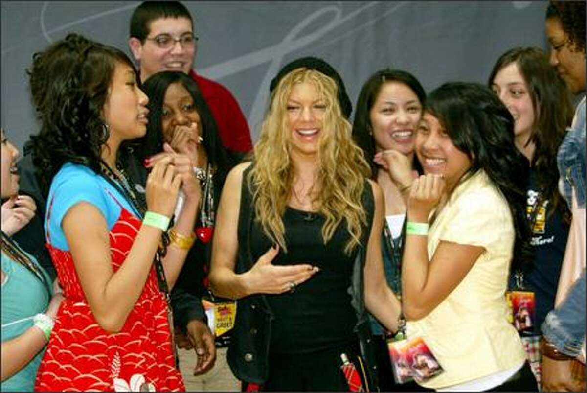 Fergie meets Franklin High School students prior to her private concert.