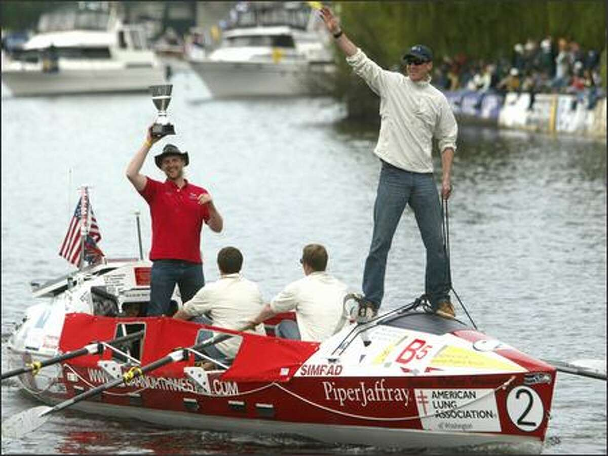 The Oar Northwest team that won the crossing of the Atlantic last year waves to the crowd during the opening day parade.