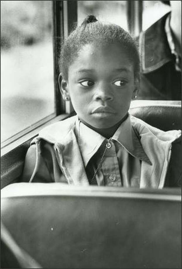 Minor Elementary School student Phyllis Mitchell listens to the bus driver on May 18, 1978. (Kerry Coughlin/P-I)