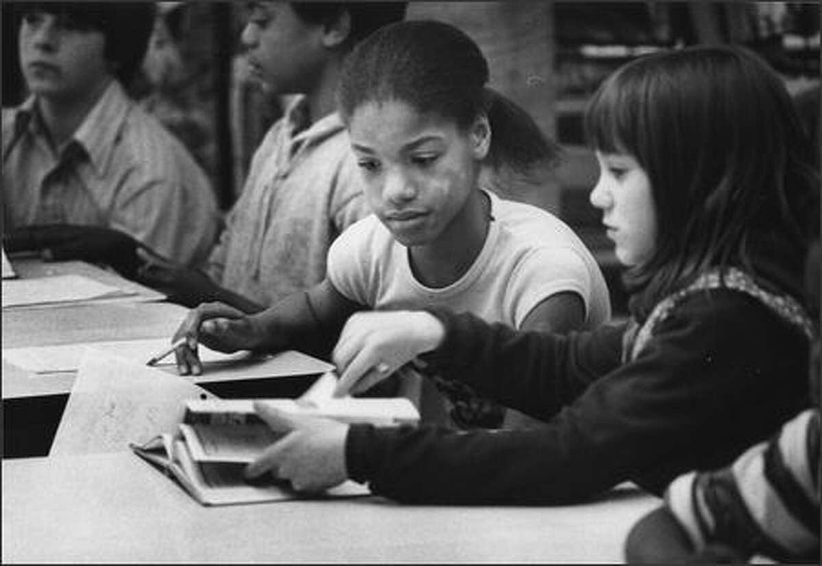 Celeste Richardson, left, works with Connie Mohlik on April 20, 1978, during a Dearborn Park Elementary visit for Magnolia kids. (Cary W. Tolman/P-I)