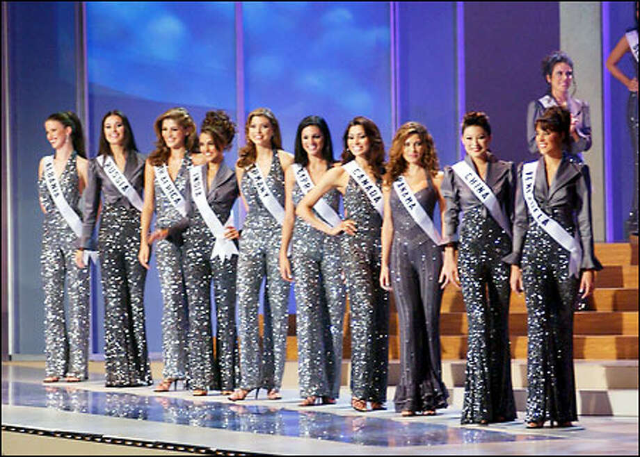 Contestants pose after being named the top 10 semi-finalists in the 2002 Miss Universe competition at the Roberto Clemente Coliseum in San Juan, Puerto Rico, on Wednesday, May 29, 2002. From left to right are: Anisa Kospiri, Miss Albania 2002; Oxana Fedorova, Miss Russia 2002; Vanessa Carreira, Miss South Africa 2002; Neha Dhupia, Miss India 2002; Natascha Borger, Miss Germany 2002; Demetra Eleftheriou, Miss Cyprus 2002; Neelam Verma, Miss Canada Universe 2002; Justine Pasek, Miss Panama 2002; Ling Zhuo, Miss China 2002; and Cynthia Lander Zamora, Miss Venezuela 2002. Photo: Seattle Post-Intelligencer