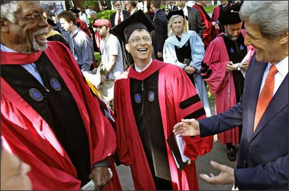 Co-founder of Microsoft Bill Gates, center, laughs with Sen. John Kerry, D-Mass., right, as Boston Celtics legend Bill Russell, left, looks on before the start of commencement ceremonies at Harvard University in Cambridge, Mass., Thursday. Photo: Associated Press