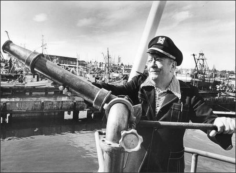 Ivar Haglund standing with a fire nozzle which was on his vessel