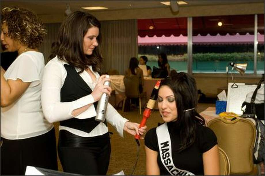 During registration and fittings for the 2007 Miss USA competition at the Wilshire Grand Hotel in Los Angeles on March 8, Despina Delios, Miss Massachusetts USA 2007, has her hair styled by Farouk Stylist Daniele Bucco. Photo: Miss Universe L.P., LLLP