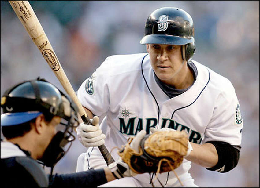 Bret Boone watches Royals' catcher Brent Mayne catch the ball just before hitting a home run in the second inning.