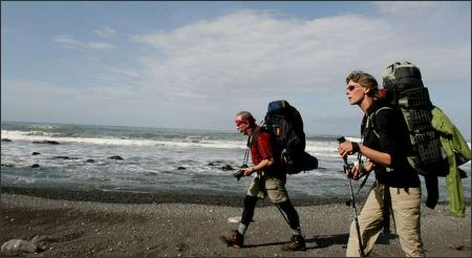 Greg and Lorna Johnston hiking Northern California's Lost Coast Trail. Much of the remote trail is on the beach, making for slow progess. Some of the trail is impassable at high tide. Photo: Paul Joseph Brown, Seattle Post-Intelligencer
