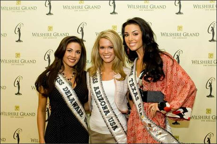 Nicole Bosso, Miss Delaware USA 2007, Courtney Lorraine Barnas, Miss Arizona USA 2007, and Magen Ellis, Miss Texas USA 2007, pose at the Wilshire Grand Hotel in Los Angeles on March 8 before registration and fittings for the Miss USA 2007 competition. Photo: Miss Universe L.P., LLLP