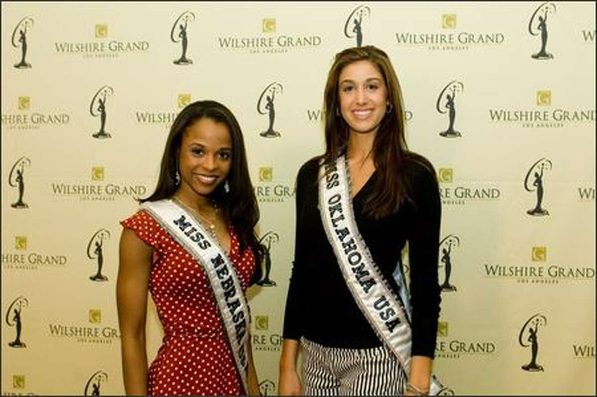 Geneice Irene Wilcher, Miss Nebraska USA 2007, and Caitlin Irene Simmons, Miss Oklahoma USA 2007, pose at the Wilshire Grand Hotel in Los Angeles on March 8 before registration and fittings for the Miss USA 2007 competition.